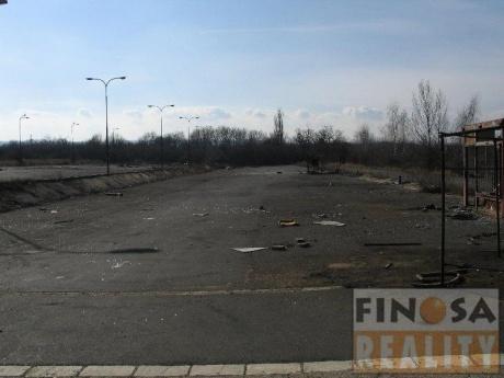 Pronájem pozemku - zpevněné plochy - pro komerční účely v Lenešicích, okr. Louny.